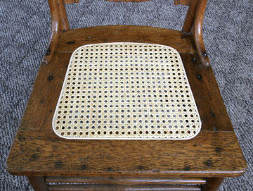 Finished chair seat with cane webbing