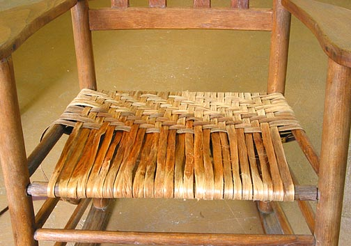 Chair with about half the rows woven.